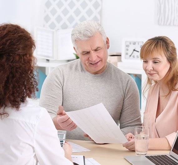 Older white couple looking over a document